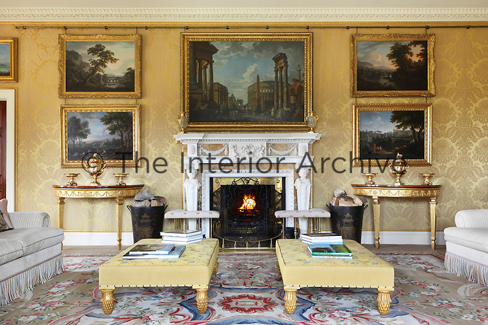 The more formal character of the large drawing room is enhanced by the Old Master paintings hung on the damask walls