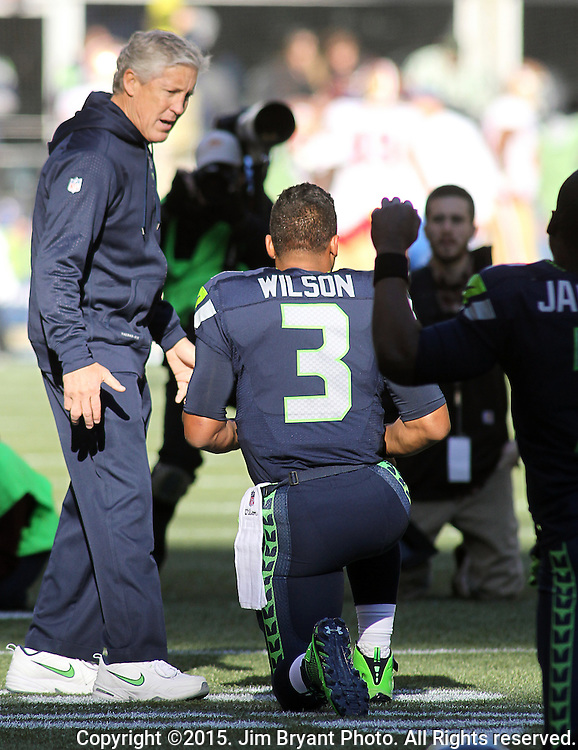 Seattle Seahawks head coach Pete Carroll talks to quarterback Russell Wilson before their game with the San Francisco 49ers at CenturyLink Field in Seattle, Washington on November 22, 2015.  The Seahawks beat the 49ers 29-13.   ©2015. Jim Bryant Photo. All RIghts Reserved.