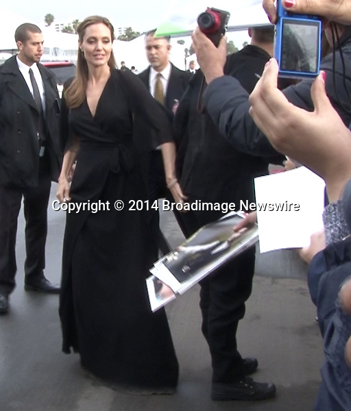 Pictured: Brad Pitt and Angelina Jolie<br /> Mandatory Credit &copy; Fernando Allende/Adriano Camolese/Broadimage<br /> Angelina Jolie gives spanks Brad's Pitt butt as they sign autographs in Santa Monica<br /> <br /> 3/1/14, Santa Monica, California, United States of America<br /> Reference: 030114_FALA_BDG_053<br /> <br /> Broadimage Newswire<br /> Los Angeles 1+  (310) 301-1027<br /> New York      1+  (646) 827-9134<br /> sales@broadimage.com<br /> http://www.broadimage.com