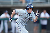 Blaine Griffiths (20) of the Xavier Musketeers hustles down the first base line against the Penn State Nittany Lions at Coleman Field at the USA Baseball National Training Center on February 25, 2017 in Cary, North Carolina. The Musketeers defeated the Nittany Lions 10-4 in game one of a double header. (Brian Westerholt/Four Seam Images)