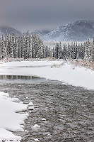 Winter landscape of the Jim River and Brooks Range mountains during freeze up, Arctic, Alaska.