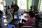 Vietnam War veteran Robert Lindstrom grins at a young woman at a day care center for children affected by dioxin exposure near Da Nang, Vietnam. The Da Nang Association of Victims of Agent Orange/Dioxin says that more than 5,000 people -- including 1,400 children -- around the city suffer from mental and physical disabilities caused by dioxin exposure, the result of the U.S. military's use of Agent Orange during the Vietnam War more than 40 years ago. About 200 children attend three centers operated by the group, where they are taught to read and write and socialize with other children. Some young adults are taught how to sew, make incense and handicrafts, with the goal of enabling them to work and make money for themselves and their families. The Vietnam Red Cross says that more than 3 million people suffer from illnesses related to Agent Orange and dioxin exposure, including at least 150,000 children born with severe birth defects since the end of the war. The U.S. government started paying last year to clean up dioxin-contaminated soil at the Da Nang airport, which served as a major U.S. base during the conflict. However, the U.S. government still denies that dioxin is to blame for widespread health problems in Vietnam and has never provided any money specifically to help the country's Agent Orange victims. March 18, 2013.