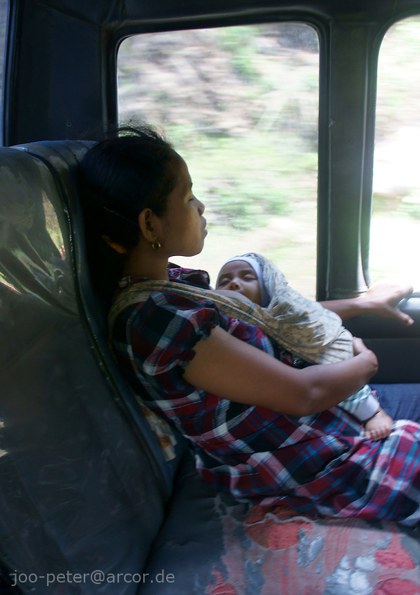 woman and child in public bus, island  Flores in archipelago of Indonesia
