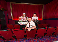 BNPS.co.uk (01202 558833)<br /> Pic: PhilYeomans/BNPS<br /> <br /> Film nut Andy with wife Jane and son Ethan.<br /> <br /> Field of Dreams....<br /> <br /> Film buff Andy Jones has built an ABC cinema in his back garden as a lasting tribute to the now defunct movie company.<br /> <br /> Andy, 38, has taken four and a half years and spent &pound;70,000 of his life savings building the 34-seat cinema from scratch.<br /> <br /> The father-of-two's movie house mirrors cinemas of the 1930s with big red curtains, red seats and a parquet floor in the projection room. <br /> <br /> The brick building, which is adorned with an ABC sign, is 40ft tall, 22ft wide and 20ft high and takes up half of the garden of his three bed semi-detached house.<br /> <br /> The theatre, which has a 17ft by 7ft screen, has its own projection room, black and white old-style toilets and a foyer with a concessions stand that offers popcorn and sweets.