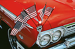 1960s Chevrolet car red chevy with american flags