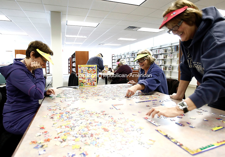 """Middlebury, CT- 27 February 2014-022714CM06- COUNTRY LIFE----  """"The 4 Easy Pieces"""", Mary Rose McArdle, of Waterbury, left, Faith L'Heureux of Middlebury and Marci Dwyer of Southbury, during the 7th annual Middlebury Library Jigsaw Puzzle Competition, at the library on Thursday.  The event, sponsored by the Friends of the Middlebury Public Library featured 7 teams working on a 1,000 piece puzzle.   Christopher Massa Republican-American"""