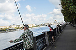 A man fishes in the Moscow River in Gorky Park on Saturday, August 17, 2013 in Moscow, Russia.