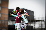 West Ham United 2 Crystal Palace 2, 02/04/2016. Boleyn Ground, Premier League. Home forward Diafra Sakho (left) is challenged by Damien Delaney during the second-half at the Boleyn Ground as West Ham United hosted Crystal Palace in a Barclays Premier League match. The Boleyn Ground at Upton Park was the club's home ground from 1904 until the end of the 2015-16 season when they moved into the Olympic Stadium, built for the 2012 London games, at nearby Stratford. The match ended in a 2-2 draw, watched by a near-capacity crowd of 34,857. Photo by Colin McPherson.