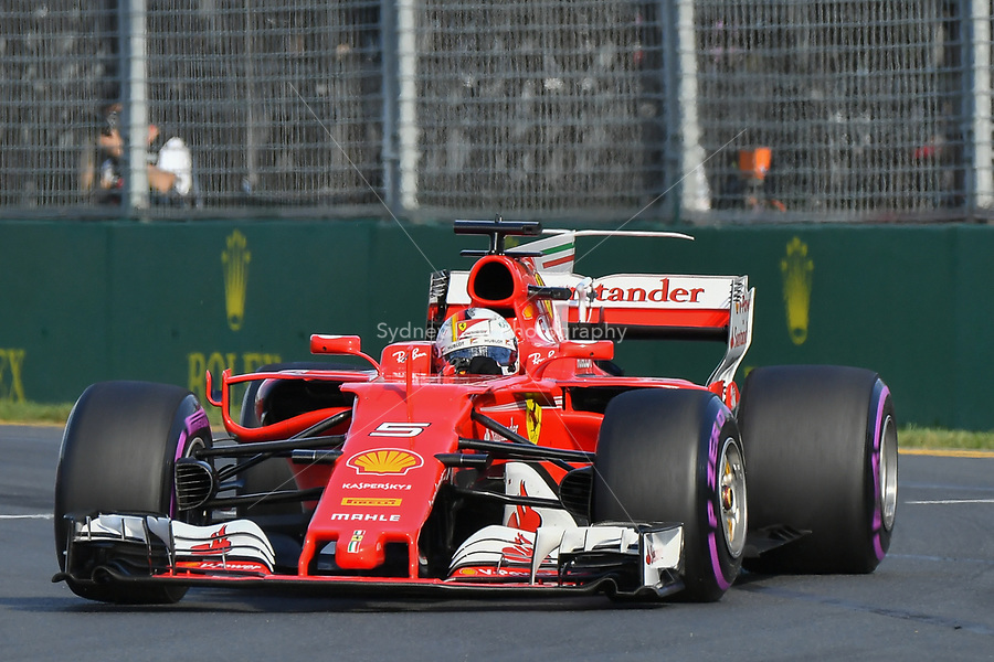 March 26, 2017: Sebastian Vettel (DEU) #5 from the Scuderia Ferrari team rounds turn one at the 2017 Australian Formula One Grand Prix at Albert Park, Melbourne, Australia. Photo Sydney Low