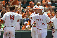 Texas Longhorns designated hitter Madison Carter (35) is greeted by teammate Ben Johnson(14) during the NCAA Super Regional baseball game against the Houston Cougars on June 7, 2014 at UFCU Disch–Falk Field in Austin, Texas. The Longhorns are headed to the College World Series after they defeated the Cougars 4-0 in Game 2 of the NCAA Super Regional. (Andrew Woolley/Four Seam Images)