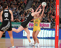 16.09.2012 Silver Ferns Katrina Grant and Australian Natalie Medhurst in action during the first netball test match between the Silver Ferns and the Australian Diamonds played at the Hisense Arena In Melbourne. Mandatory Photo Credit ©Michael Bradley.