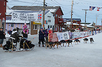 Nathan Schroeder runs into the finish chute toward the finish line in Nome on Thursday March 19, 2015 during Iditarod 2015.  <br /> <br /> (C) Jeff Schultz/SchultzPhoto.com - ALL RIGHTS RESERVED<br />  DUPLICATION  PROHIBITED  WITHOUT  PERMISSION