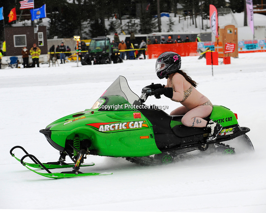 Tara Pulec races her Arctic Cat during the Bikini Run held at the 2015 St. Germain Radar Run on Little St. Germain Lake, St. Germain, WI. She was the top fundraiser for the Bikini Run racers.