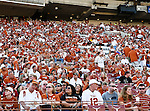 Texas Longhorns fans watch the action during the game between the Brigham Young Cougars and the Texas Longhorns at the Darrell K Royal - Texas Memorial Stadium in Austin, Texas. Texas defeats Brigham Young 17 to 16...