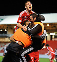 ABERDEEN'S JOSH MAGENNIS IS MOBBED AFTER HE SCORES ABERDEEN'S EQULAISING THIRD