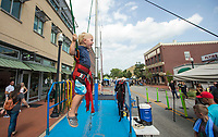 NWA Democrat-Gazette/BEN GOFF @NWABENGOFF<br /> Bryson Hazzard, 2, of Stillwater, Okla. jumps on the Flippin Crazy bungee trampoline Friday, July 5, 2019, during First Friday on the Bentonville Square. The theme for July was 'Great Outdoors.'