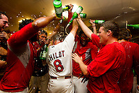 Members of the Springfield Cardinals pour non-alcoholic champagne on Manager Mike Shildt (8) of the Springfield Cardinals while celebrating in the clubhouse after beating the Tulsa Drillers in the North Division Championship game at Hammons Field on September 9, 2012 in Springfield, Missouri. (David Welker/Four Seam Images)