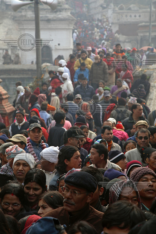 Crowds of people move through Kathmandu's Pashpatinath temple complex.