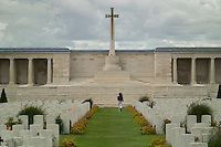 A young visitor run through Pozieres British Cemetery for the dead of World War I in Pozieres, La Somme, France, August 18, 2014. 2014 marks 100th anniversary of the Great War.