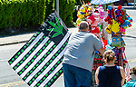 WINSTED,  CT-051819JS05- FOR BRASS TACKS-- Is that flag appropriate to sell from vendors during a kid-friendly parade like the 83rd annual Rotary Club Pet Parade along Main Street in Winsted on Saturday. <br /> Jim Shannon Republican American