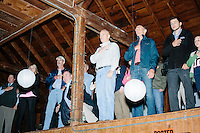 People say the Pledge of Allegiance before Republican presidential candidate and former Florida governor Jeb Bush speaks to a crowd in the barn of Dr. and Mrs. James Betti in Rye, New Hampshire, for former Massachusetts senator Scott Brown's No B.S. BBQ series.
