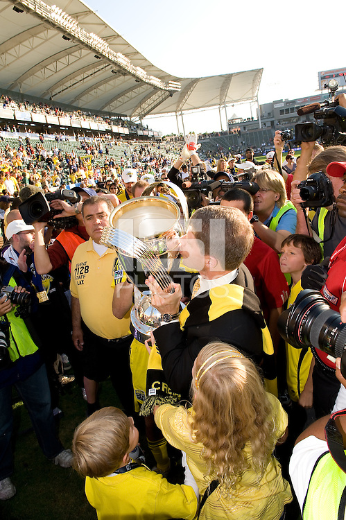Clark Hunt kisses the MLS Cup trophy during MLS Cup 2008. Columbus Crew defeated the New York Red Bulls, 3-1, Sunday, November 23, 2008. Photo by John Todd/isiphotos.com