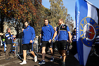 Rob Webber, Dom Day and Ross Batty make their way through a tunnel of supporters prior to the match. Aviva Premiership match, between Bath Rugby and Harlequins on October 31, 2015 at the Recreation Ground in Bath, England. Photo by: Robbie Stephenson / JMP for Onside Images