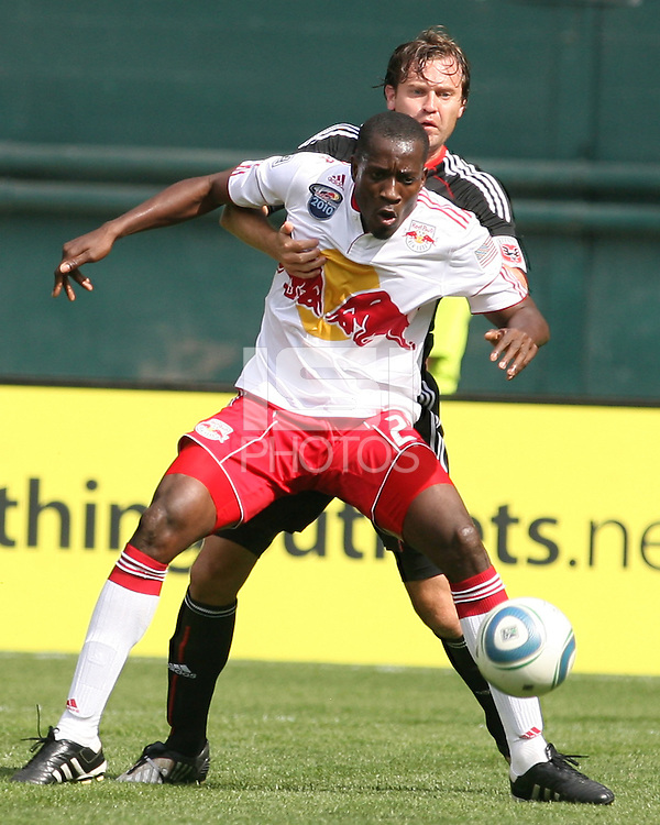 Carey Talley #8 of D.C. United holds onto Ibrahim Salou #29 of the New York Red Bulls during an MLS match on May 1 2010, at RFK Stadium in Washington D.C.