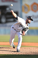 Asheville Tourists pitcher Scott Firth (23) delivers a pitch during game one of a double header against the Hickory Crawdads on April 21, 2015 in Asheville, North Carolina. The Crawdads defeated the Tourists 10-1. (Tony Farlow/Four Seam Images)