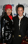 Tamara Tunie poses with Olympic skater Johnny Weir at the 2009 Skating with the Stars - a benefit gala for Figure Skating in Harlem on April 6, 2009 at Wollman Rink, Central Park, NYC, NY. (Photo by  Sue Coflin/Max Photos)