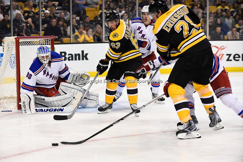 September 24, 2015 - Boston, Massachusetts, U.S. - Boston Bruins left wing Brad Marchand (63) and Boston Bruins left wing Loui Eriksson (21) battle to get control of the puck as New York Rangers goalie Jeff Malcolm (80) protects the goal during the NHL game between the New York Rangers and the Boston Bruins held at TD Garden, in Boston, Massachusetts. The Bruins defeat the Rangers 4-3 in an overtime shoot out. Eric Canha/CSM