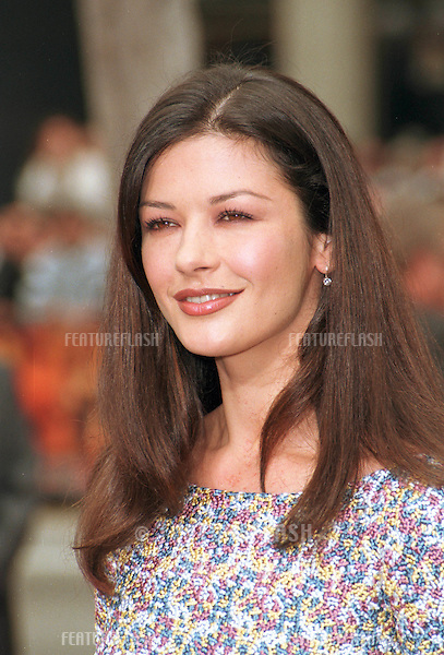 "13APR99:  Actress CATHERINE ZETA JONES at Hollywood's Manns Chinese Theatre where Sean Connery had his hand & footprints set in cement. .Their new movie, ""Entrapment,"" opens this week.    .© Paul Smith/Featureflash"