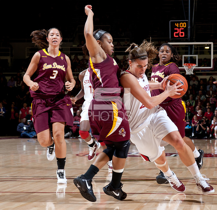 STANFORD, CA - January 8, 2011: Jeanette Pohlen of the Stanford Cardinal women's basketball team drives to the basket during Stanford's game against Arizona State at Maples Pavilion. Stanford won 82-35.
