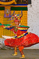 Masked dancers, Dance of the Lord of Death at the Paro Teschu festival, Paro Dzong Monastery,  Paro Valley, Bhutan