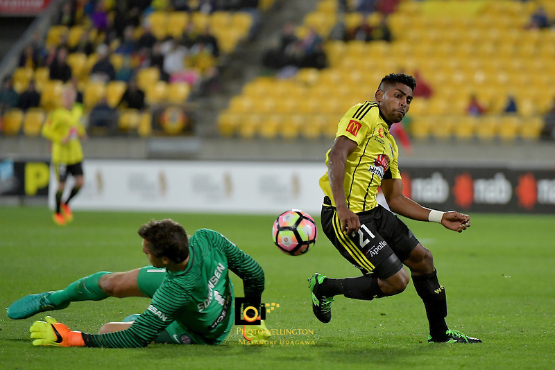 Wellington Phoenix&rsquo;  Roy Krishna and Melbourne City FC's Thomas Sorensen in action during the A League - Wellington Phoenix v Melbourne City FC at Westpac Stadium, Wellington, New Zealand on Saturday 8 October 2016.<br /> Photo by Masanori Udagawa. <br /> www.photowellington.photoshelter.com.
