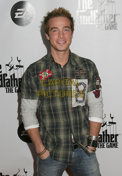 RYAN CARNES.Godfather The Game Premiere held at Privilege, West Hollywood, California, USA..March 15th, 2006.Photo: Byron Purvis/AdMedia/Capital Pictures.Ref: BP/ADM.half length shirt green plaid  shirt.www.capitalpictures.com.sales@capitalpictures.com.© Capital Pictures.