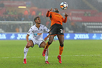 (L-R) Kyle Naughton of Swansea City stands behind Bright Enobakhare of Wolverhampton Wanderers during the Emirates FA Cup match between Swansea and Wolverhampton Wanderers at the Liberty Stadium, Swansea, Wales, UK. Wednesday 17 January 2018