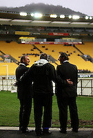 Perth coach David Mitchell wishes Phoenix coach Ricki Herbert and Phoenix CEO Tony Pignata well before the match during the A-League football match between Wellington Phoenix and Perth Glory at Westpac Stadium, Wellington, New Zealand on Sunday, 16 August 2009. Photo: Dave Lintott / lintottphoto.co.nz