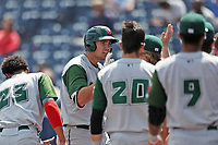 Fort Wayne TinCaps first baseman Brad Zunica (35) is greeted by his teammate after hitting a home run against the West Michigan Michigan Whitecaps during the Midwest League baseball game on April 26, 2017 at Fifth Third Ballpark in Comstock Park, Michigan. West Michigan defeated Fort Wayne 8-2. (Andrew Woolley/Four Seam Images)