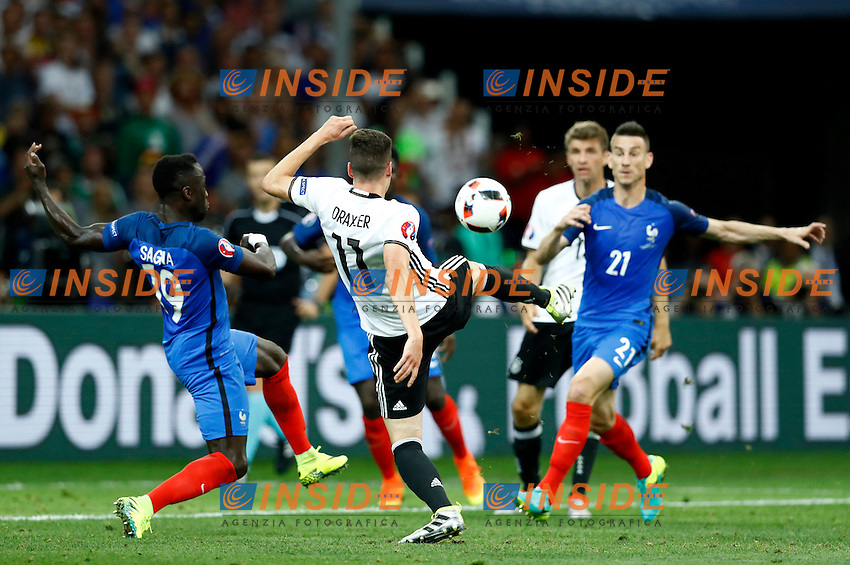 Julian Draxler (Germany) in action between Bacary Sagna and Laurent Koscielny (France)<br /> Marseille 07-07-2016 Stade Velodrome Football Euro2016 Germany - France / Germania - Francia Semi-finals / Semifinali <br /> Foto Matteo Ciambelli / Insidefoto