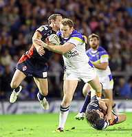 PICTURE BY ALEX WHITEHEAD/SWPIX.COM - Rugby League - Super League Play-Off - Warrington Wolves vs St Helens - The Halliwell Jones Stadium, Warrington, England - 15/09/12 - Warrington's Joel Monaghan is tackled by St Helens' Lance Hohaia and Paul Wellens.