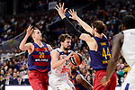 Real Madrid's Sergio Llull and FC Barcelona Lassa's Marcus Eriksson and Ante Tomic  duringTurkish Airlines Euroleague match between Real Madrid and FC Barcelona Lassa at Wizink Center in Madrid, Spain. March 22, 2017. (ALTERPHOTOS/BorjaB.Hojas)