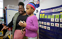 NWA Democrat-Gazette/DAVID GOTTSCHALK Tammy Davis (left) watches Tiana Smith, 4, recite the date and day of the week to her classmates Wednesday, February 14, 2018, in her's and Julie Chambers pre-k education class at the Springdale Early Childhood Center. Early education options are steadily increasing as Northwest Arkansas' population grows and people want more choices.