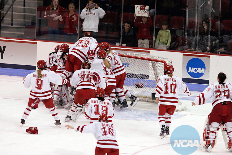 22 MARCH 2009: Members of the Wisconsin women's ice hockey team celebrate their victory by making a dog pile at the Division I Women's Hockey Championship held at Agganis Arena on the Boston University campus in Boston, MA. Wisconsin defeated Mercyhurst 5-0 for the national title. Adam Hunger/NCAA Photos