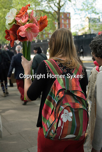 Chelsea Flower Show London. End of week long flower show visitors are able to buy exhibits to take home.