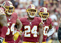 Washington Redskins cornerback Josh Norman (24) waits for the Cleveland Browns offense to come to the line during first quarter action at FedEx Field in Landover, Maryland on October 2, 2016.  Pictured with Norman are Washington Redskins inside linebacker Mason Foster (54) and strong safety David Bruton (30).  The Redskins won the game 31 - 20.<br /> Credit: Ron Sachs / CNP /MediaPunch ***EDITORIAL USE ONLY***