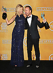 Anna Gunn and Aaron Paul in the press room at the 20th Annual Screen Actors Guild Awards, held at the Shrine Auditorium Los Angeles, Ca. January 18, 2014.
