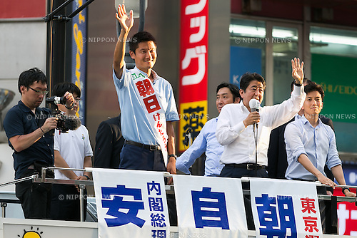 (L to R) Kentaro Asahi, former beach volleyball star and LDP candidate with Shinzo Abe, leader of the Liberal Democratic Party and Prime Minister of Japan greet supporters during a campaign event in Shibuya on July 3, 2016, Tokyo, Japan. Abe came to support Asahi's campaign for July 10th's House of Councillors elections. (Photo by Rodrigo Reyes Marin/AFLO)