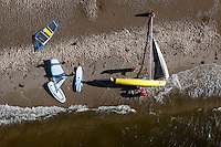 Windsurfers and a dingy on the beach in the Bay of Puck (Zatoka Pucka).