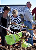 NWA Democrat-Gazette/DAVID GOTTSCHALK Courtney Kremer (left), director of Animal Services for the City of Springdale, participates Tuesday, October 8, 2019, with her dog Rufus in the ground breaking ceremony for the new Animal Shelter and Adoption Center of Springdale. The new facility, located at 1549 E. Don Tyson Parkway, was made possible by a 2018 $200 million bond program voted on by residents that also includes money for streets, fire stations and a new city administration building.